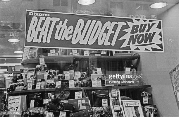 Sign reading 'Beat The Budget - Buy Now' in a Dixons camera shop on Fleet Street, London, on Budget Day, UK, 26th March 1974.