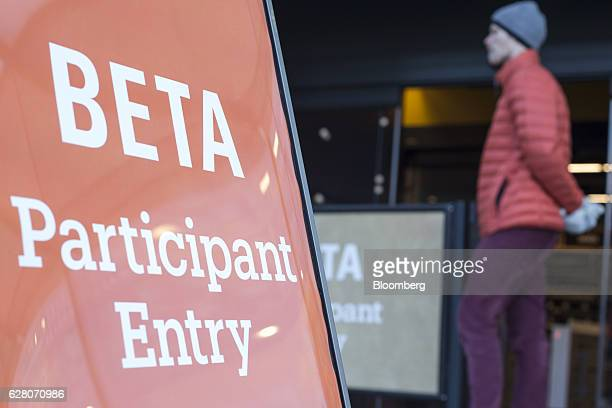 A sign reading 'Beta Participant Entry' stands outside the new Amazon Go grocery store in Seattle Washington US on Tuesday Dec 6 2016 Amazoncom Inc...