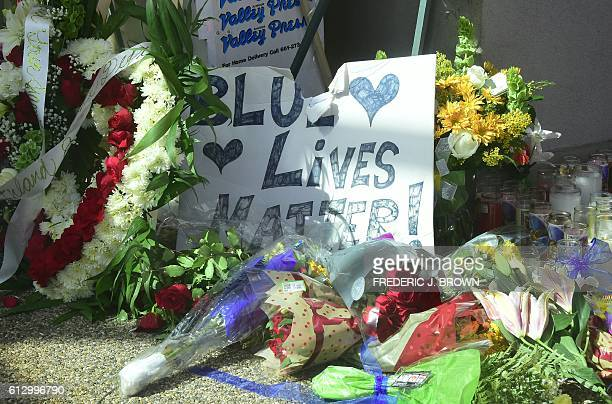 A sign reading 'Blue Lives Matter' is seen at a memorial outside the Los Angeles County Sheriff's Department office in Lancaster California on...