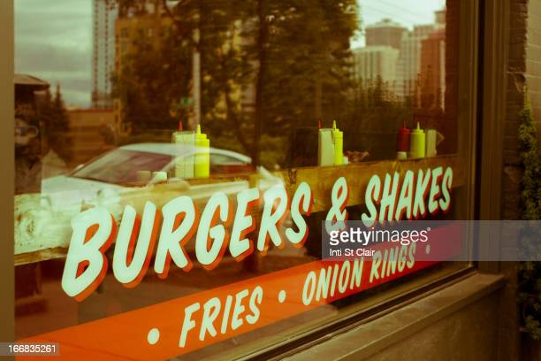Sign reading burgers & shakes on restaurant window