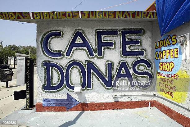 WITH LIVING EN EEUU IN 'SPANGLISH' LENGUA O DIALECTO BY MARIA LORENTE A sign reading Cafe Donas is displayed outside a coffee shop in Los Angeles 17...