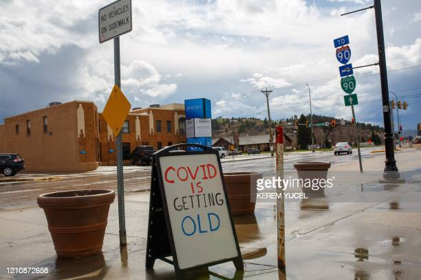 """Sign reading """"COVID is getting old"""" is seen on April 23, 2020 in Rapid City, South Dakota, amid the novel coronavirus pandemic. - South Dakota, known..."""