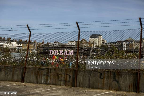A sign reading 'Dream' sits beyond a fence in the Dreamland resort in Margate UK on Thursday Oct 10 2019 Nick Niell the man behindArrowgrass Capital...