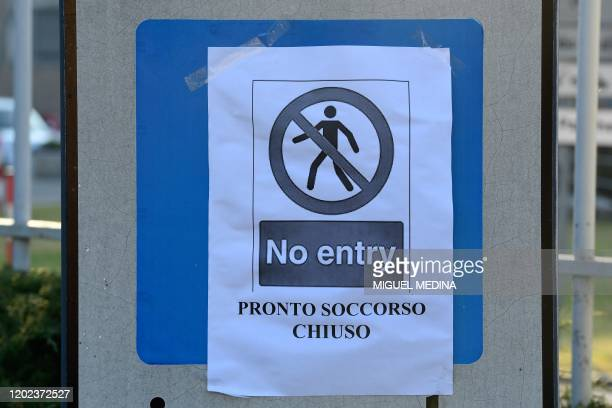 "Sign reading ""Emergency Department Closed"" is put up at the entrance of the municipal hospital in Codogno, southeast of Milan, on February 22, 2020...."