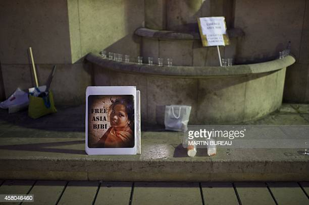 A sign reading Free Asia Bibi is placed on display as people demonstrate on the Parvis des droits de l'homme in Paris on October 29 to protest...
