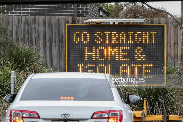 A sign reading 'Go straight home and Isolate' is seen at the exit of a drive through covid19 testing site at Highpoint shopping centre on July 04...