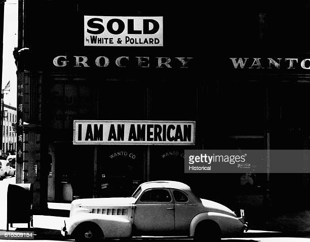 An Oakland California grocery store bears a SOLD sign as well as one proclaiming the patriotic loyalty of its owner The JapaneseAmerican owner of the...