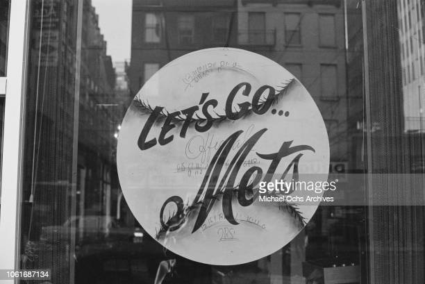 A sign reading 'Let's Go Mets' in support of the New York Mets baseball team in Midtown Manhattan New York City circa 1968