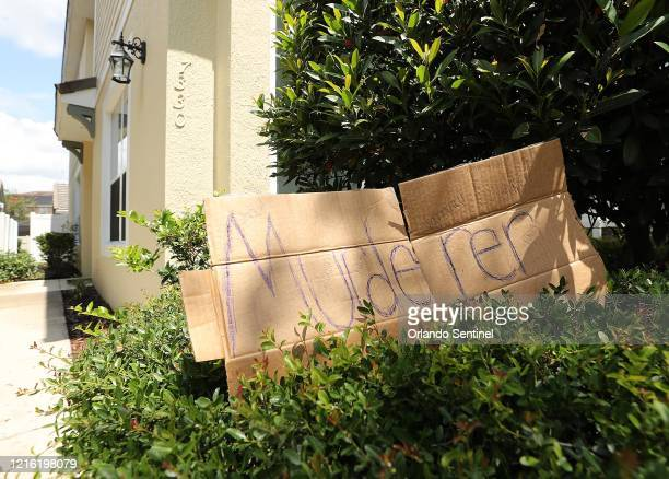 Sign reading Murderer is placed on Friday, May 29 outside a home in Windermere, Florida, owned by Derek Chain, the Minneapolis police officer...