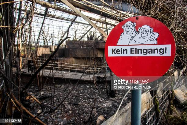 A sign reading No Entrance is seen at the burnedout monkey house of the zoo in Krefeld western Germany on January 1 2020 Fire ripped through the...