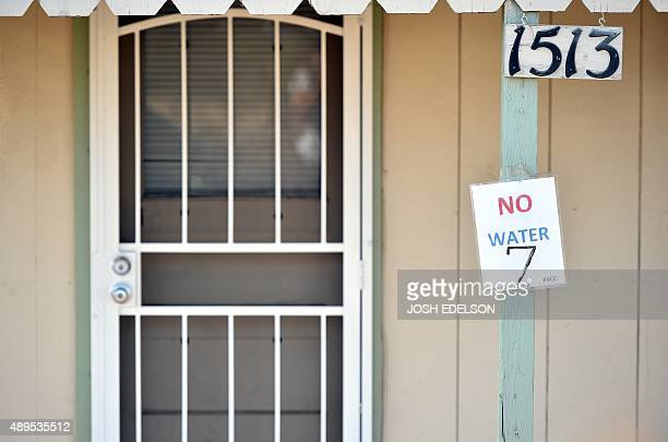A sign reading no water and indicating the number of people living inside is seen posted on a house in Porterville California on September 21 2015...