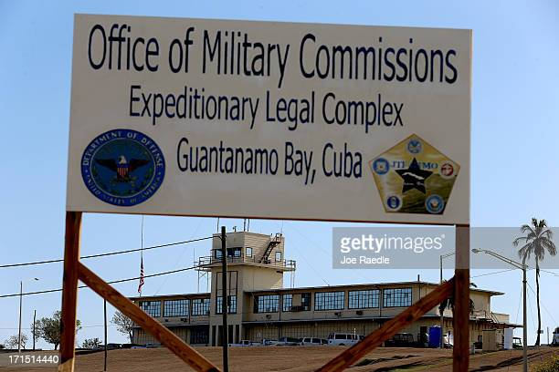 "Sign reading, ""Office of Military Commissions Expeditionary Legal Complex Guantanamo Bay, Cuba"" stands close to where pre-trial hearings are being..."