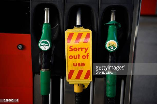 """Sign reading """"out of use"""" is pictured on a diesel fuel pump, next to pumps for unleaded petrol at a petrol station in north London on November 18,..."""