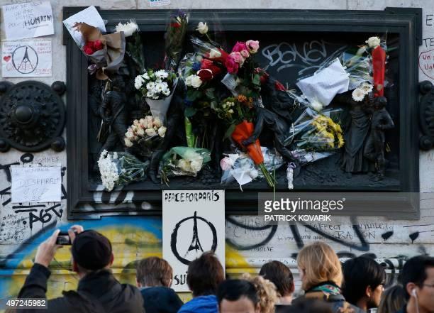 Sign reading 'Peace for Paris' is seen as people gather around the Monument a la Republique, at the Place de la Republique in Paris, on November 15...