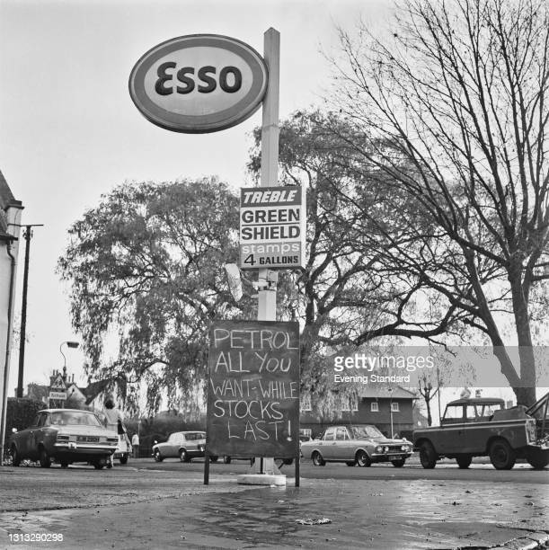 Sign reading 'Petrol - All You Want While Stocks Last!' at an Esso petrol station on Kensington Avenue, Thornton Heath, London, during the 1973 oil...