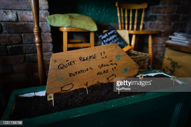 Sign reading 'Quiet Please!! Potatoes growing here!!' seen inside the Irish Potato Cake Company restaurant in Dublin's city center. On Monday, 15...