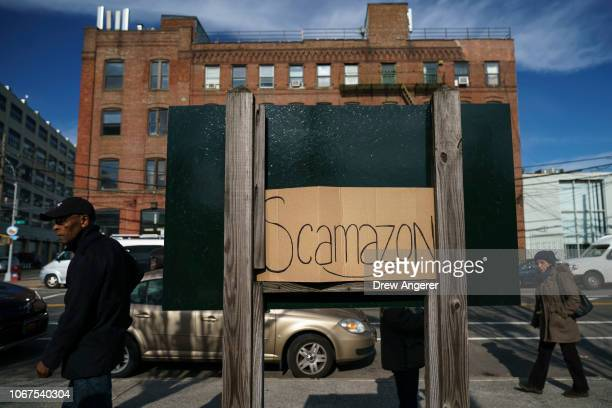 A sign reading 'Scamazon' is left behind following a protest against Amazon on November 14 2018 in the Long Island City neighborhood of the Queens...