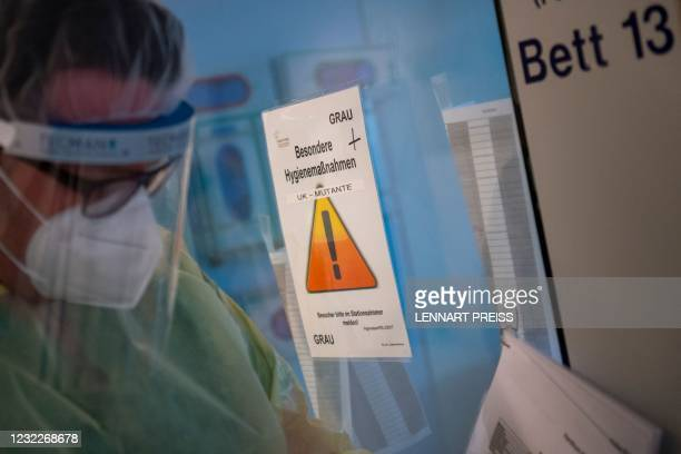 Sign reading 'Special hygiene measures - UK Mutant', referring to the UK coronavirus strain B117, is seen in an intensive care unit at the hospital...