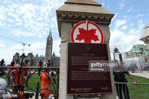 """Sign reading """"Stolen Native Land"""" during a protest in solidarity with survivors of residential schools in front of Parliament Hill on Canada Day in..."""