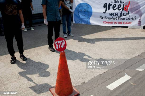 A sign reading stop is seen during the AntiEnergy Rally Activists staged a rally infront of the South Korean Embassy a day before the board of KEPCO...