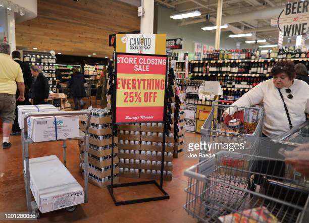 A sign reading 'store closing sale everything 25% off' is seen in a Lucky Market grocery store after the chain made public that it plans to shutter...