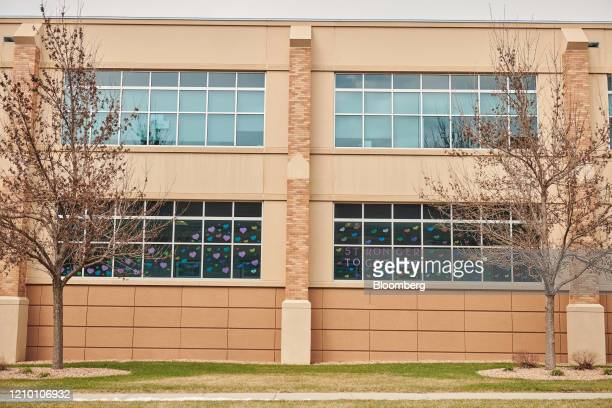 A sign reading Stronger Together is displayed outside the Sanford Health USD Medical Center in Sioux Falls South Dakota US on Wednesday April 15 2020...