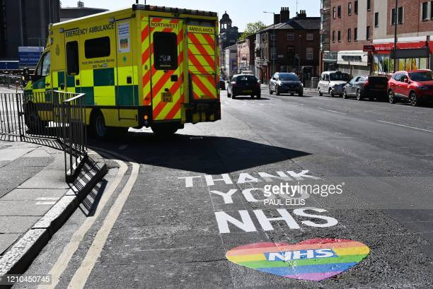 "Sign reading ""Thank You NHS"", in reference to the workers of Britain's NHS , is pictured on a road outside of the Royal Liverpool Hospital in..."