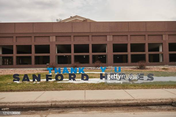 A sign reading Thank You Sanford Heroes stands on display outside Sanford Health USD Medical Center in Sioux Falls South Dakota US on Wednesday April...