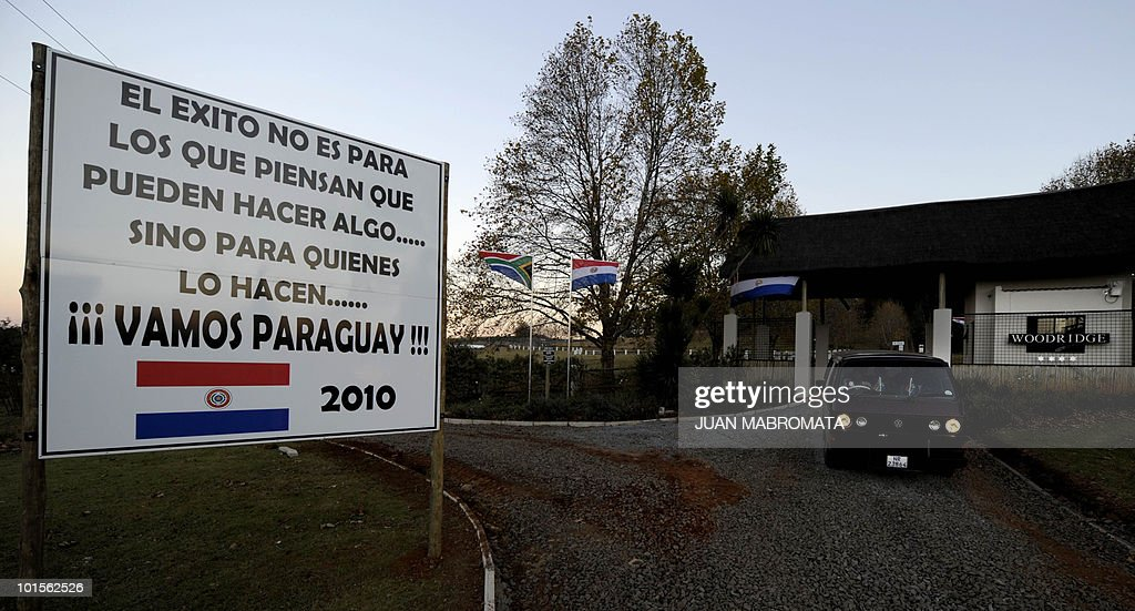 A sign reading 'The succes is not for those thinking they can do something ... but for those who do something... Go Paraguay!' is seen at the entrance of their base camp in Balgowan, some 400 km at south-east of Johannesburg, on June 2, 2010. Paraguay will take part in the FIFA 2010 World Cup hosted in South Africa from June 11 to July 11.
