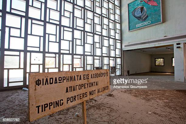 Sign reading Tipping porters not allowed at the abandoned Nicosia International Airport on April 28, 2016 in Nicosia, Cyprus .On 27 March 1968 a...