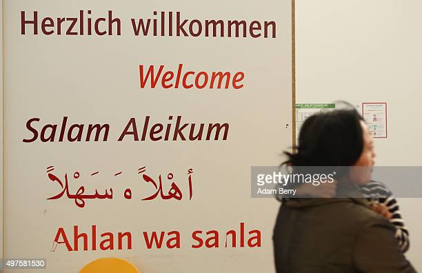 A sign reading 'Welcome' in multiple languages is seen in an airdome used as a temporary shelter for refugees on September 26 2015 in Berlin Germany...