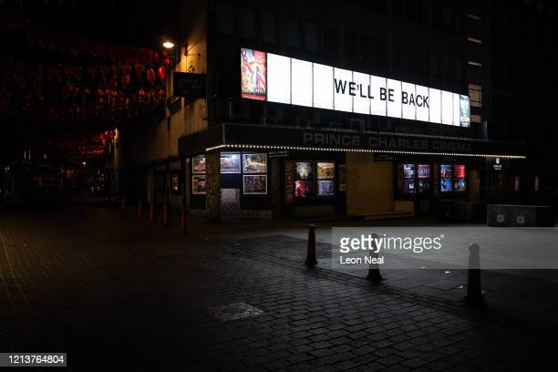 "Sign reading ""We'll Be Back"" is seen on the Prince Charles cinema near Leicester Square on March 20, 2020 in London, England. Coronavirus has spread..."