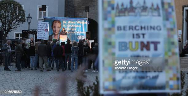 A sign reads Berching is colurful as Beatrix von Storch leading member of the rightwing Alternative for Germany political party speaks at an AfD...