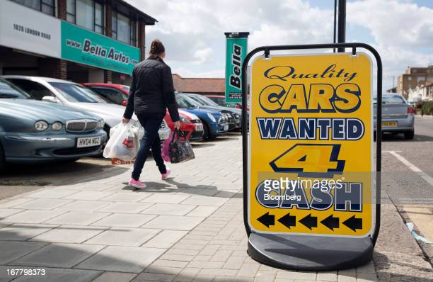 A sign reads 'Cars Wanted 4 Cash' outside an independent secondhand car dealership in LeighonSea UK on Monday April 29 2013 European car sales are...