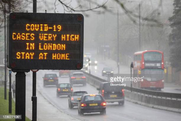 """Sign reads """"Covid-19 Cases Very High in London. Stay at Home"""" near a highway in London, U.K., on Wednesday, Dec. 23, 2020. Shops in Britain had only..."""