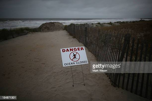 """Sign reads """"Danger Ocean Closed"""" at the entrance to the beach, due to approaching Hurricane Sandy, on October 28, 2012 in Ocean City, New Jersey. New..."""