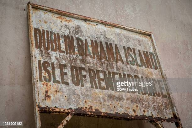 """Sign reads """"Dublin Banana Islands: Isle of Remembrance"""". The Banana Islands were once a slave trading port. They are now home to a few hundred..."""
