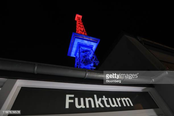 A sign reads Funkturm below the Radio Tower which has been illuminated in red and blue to mark the day the UK leaves the European Union in Berlin...