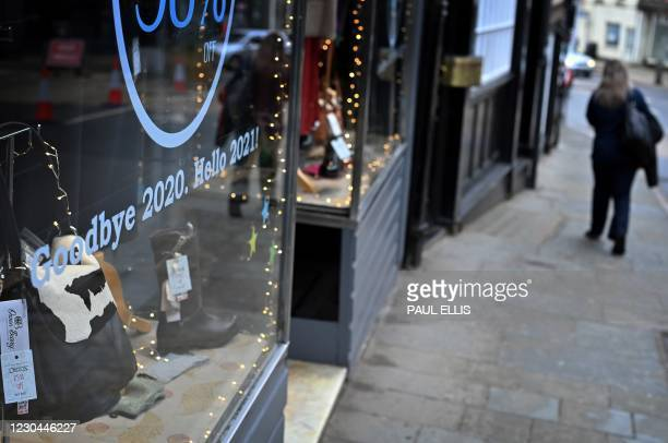 """Sign reads """"Goodbye 2020, Hello 2021, in the window of a shop, temporarily closed down due to current coronavirus restrictions, in Shrewsbury,..."""