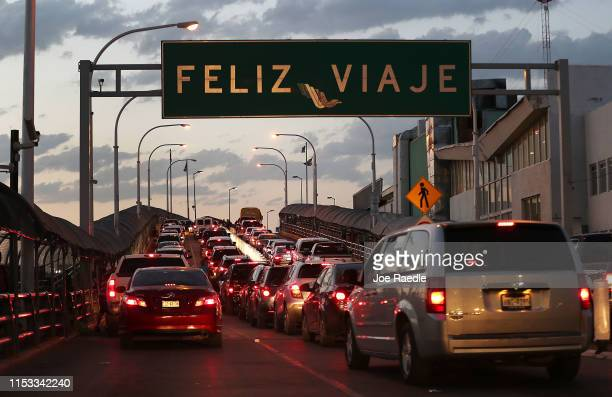 Sign reads, 'happy travels' in Spanish as traffic heads towards the United States on the Paso Del Norte Port of Entry bridge on June 02, 2019 in...