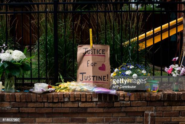 A sign reads 'Justice for Justine' at a makeshift memorial for Justine Damond on July 18 2017 in Minneapolis Minnesota Scrutiny intensified into the...