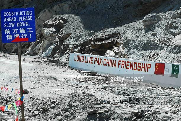 A sign reads 'Long Live PakChina Friendship' on a section of the Karakoram highway near Khunjerab Pakistan on Thursday June 25 2009 Pakistan has...