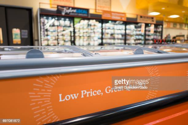 A sign reads Low Price Great Quality at Whole Foods Market grocery store in Dublin California June 16 2017 On June 16 Amazoncom announced that it...
