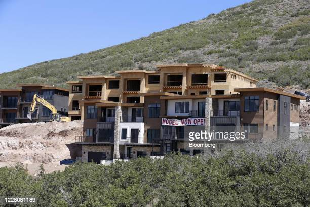 A sign reads Model Now Openoutside a home under construction in Park City Utah US on Friday Aug 14 2020 US home construction starts rose 17% in June...