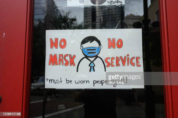 "Sign reads ""No Mask, No Service"" outside a business in Pittsburgh, Pennsylvania, U.S., on Sunday, Sept. 13, 2020. A narrow win in Pennsylvania helped..."