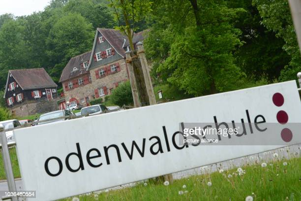 A sign reads 'Odenwaldschule' at the access road to private boarding school Odenwaldschule in OberHambach near Heppenheim Germany 29 April 2014 After...
