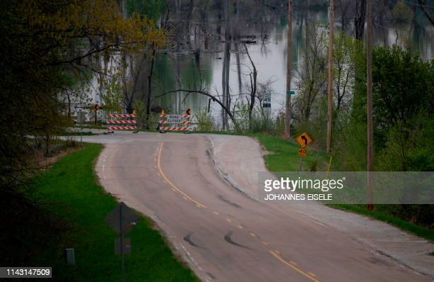 A sign reads road closed near Omaha Nebraska as the Missouri River continues to flood on May 3 2019