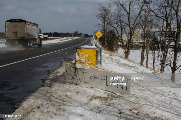 A sign reads Save GM Plant on the side of a road in front of the General Motors Co Lordstown production plant complex in Lordstown Ohio US on Monday...