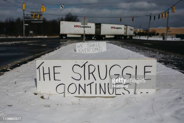 A sign reads The Struggle Continues on the side of a road in front of the General Motors Co Lordstown production plant complex in Lordstown Ohio US...