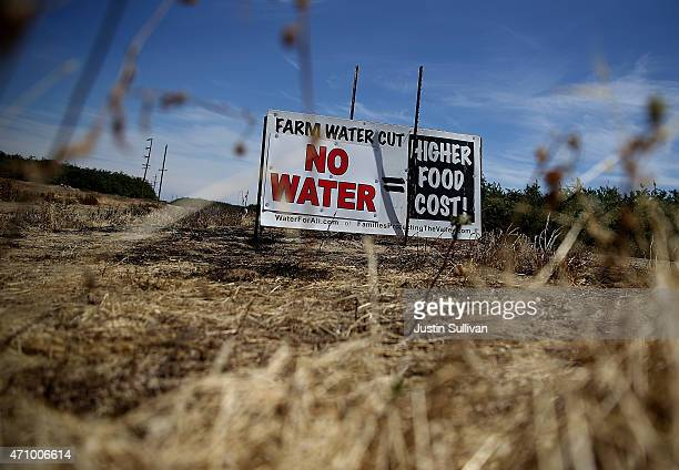 A sign referencing the drought is posted on the side of the road on April 24 2015 in Firebaugh California As California enters its fourth year of...